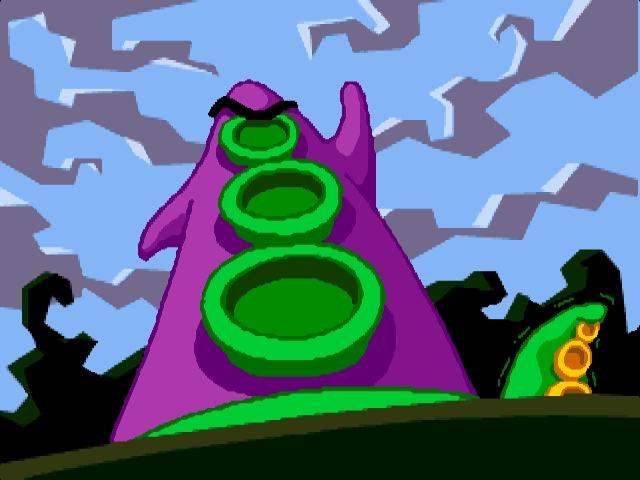 <b>Purpur-Tentakel (Erstauftritt in Maniac Mansion)</b><br><br>Ursprünglich ein Tentakel wie du und ich - aber kaum einen Schluck von Dr. Fred Edisons Mutier-Brühe geschlürft, schon wachsen Stummelarme und Weltbeherrschungstrieb! Letzterer gleich ins Unermessliche, was zu einem der brillantesten Adventures aller Zeiten führt. 1887603